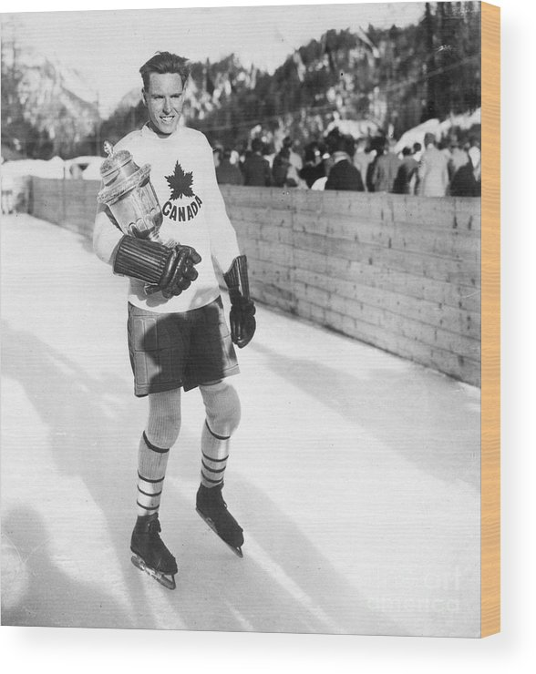 The Olympic Games Wood Print featuring the photograph Canadian Hockey Captain With Olympic by Bettmann