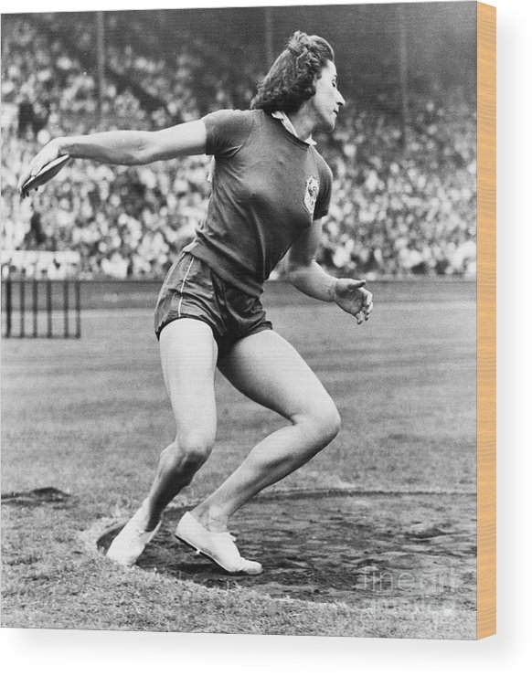 Event Wood Print featuring the photograph Micheline Ostermeyer Discuss Gold Medal by Bettmann
