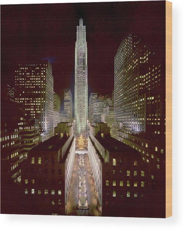 1980-1989 Wood Print featuring the photograph Rockefeller Center, Manhatten, At by Thorney Lieberman