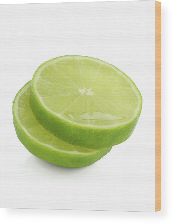 White Background Wood Print featuring the photograph Slices Of Fresh, Juicy, Freshly Cut Lime by Rosemary Calvert