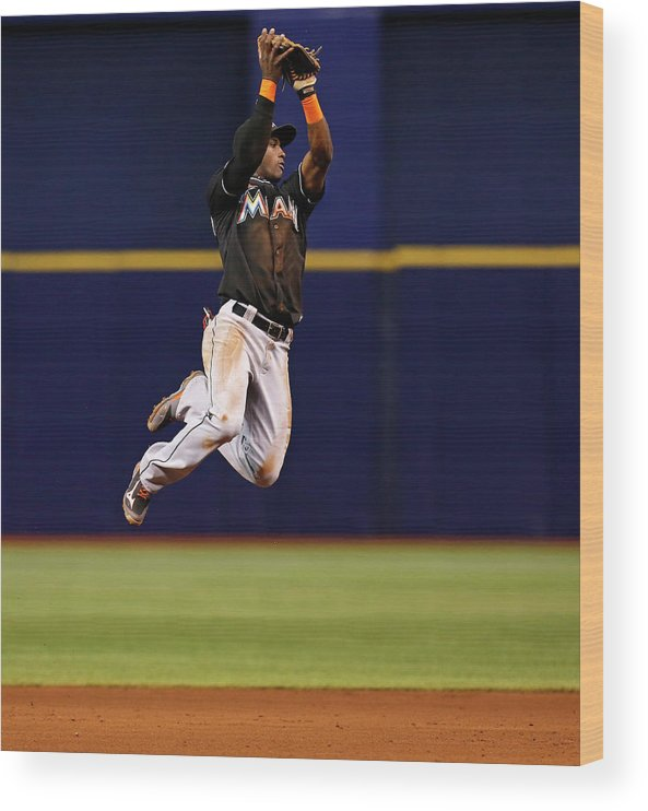 American League Baseball Wood Print featuring the photograph Adeiny Hechavarria and Yunel Escobar by Mike Carlson