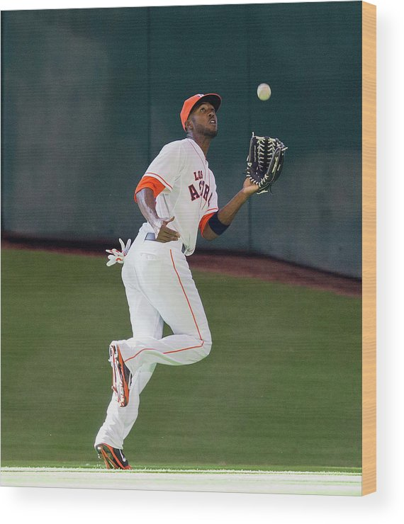 American League Baseball Wood Print featuring the photograph Cole Gillespie and Dexter Fowler by Bob Levey