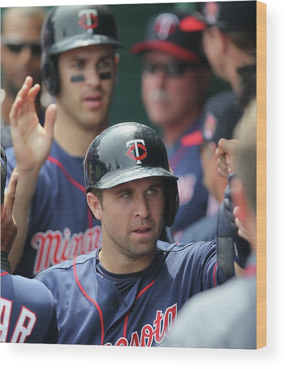 Joe Mauer Wood Print featuring the photograph Joe Mauer, Trevor Plouffe, and Brian Dozier by Ed Zurga