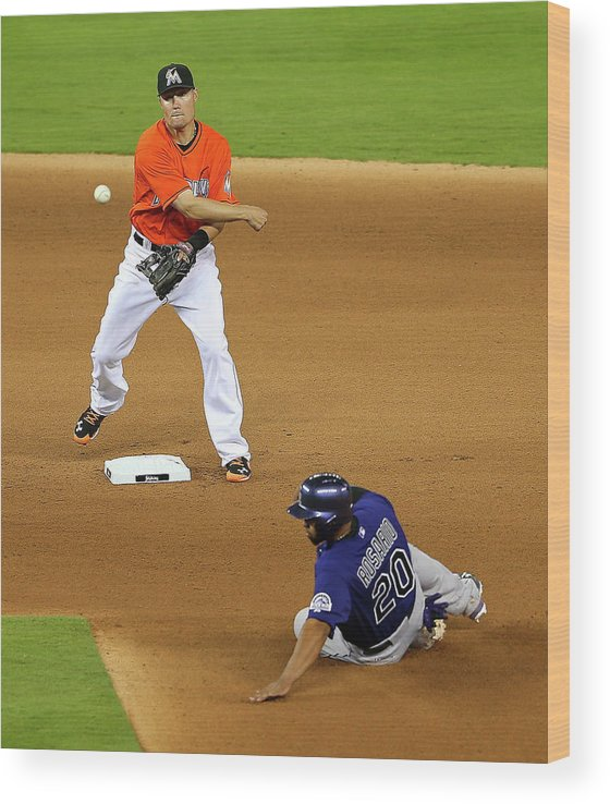 Double Play Wood Print featuring the photograph Wilin Rosario by Mike Ehrmann