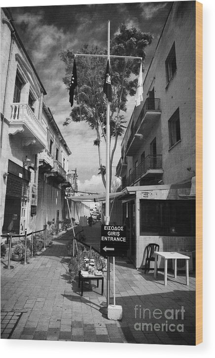 United Wood Print featuring the photograph crossing point in ledra street in the UN buffer zone in the green line dividing cyprus by Joe Fox
