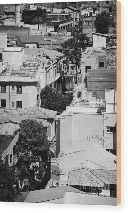 United Wood Print featuring the photograph looking down over rooftops to ledra street crossing and restricted area of the UN buffer zone by Joe Fox