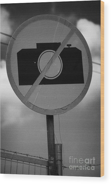 United Wood Print featuring the photograph no photography sign at the greek cypriot army border post at the UN buffer zone cyprus green line by Joe Fox