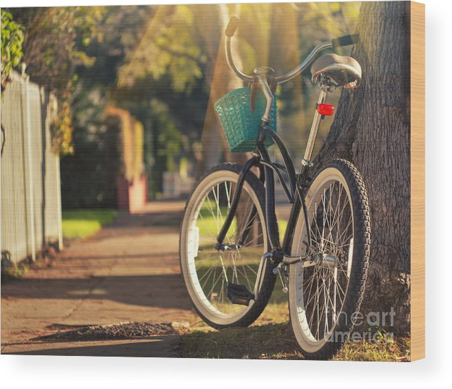 Bicycle Wood Print featuring the photograph Bicycle On Sunny Street by Konstantin Sutyagin