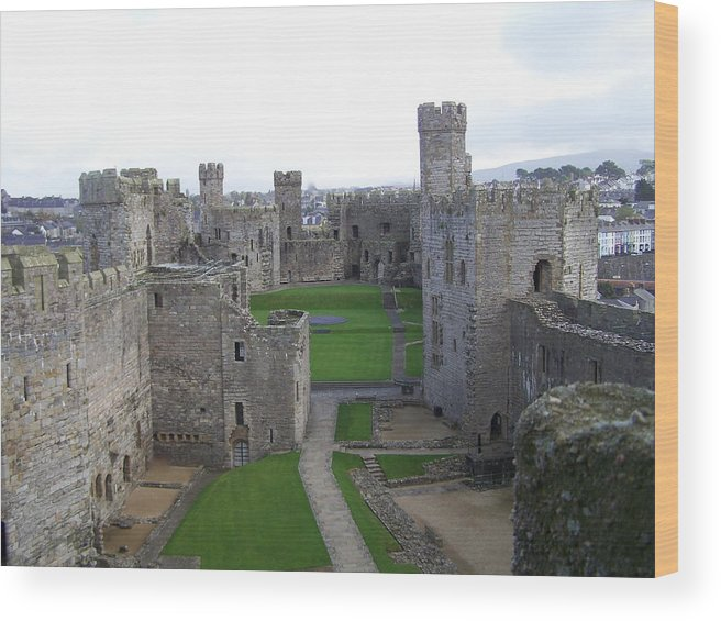 Castles Wood Print featuring the photograph Caernarfon Castle by Christopher Rowlands