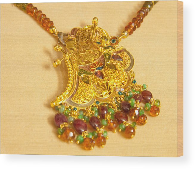 Jewel Wood Print featuring the photograph A Beautiful Intricately Carved Gold Pendant Hanging From A Semi-precious Stone Chain by Ashish Agarwal