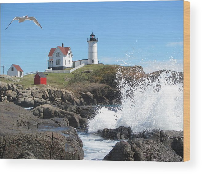 Maine Lighthouse Wood Print featuring the photograph Nubble Lighthouse With Seagull And Ocean Spray by Martin Rogers