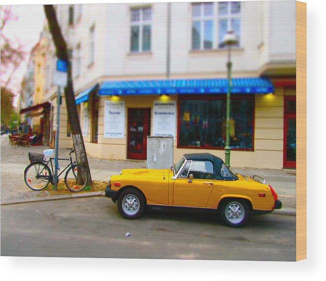Berlin Wood Print featuring the photograph The Little Yellow Car by Stephanie Olsavsky