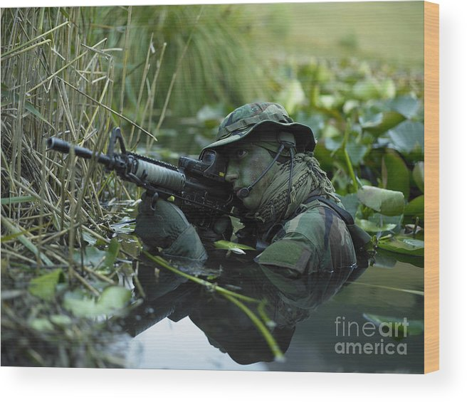 Special Operations Forces Wood Print featuring the photograph U.s. Navy Seal Crosses Through A Stream by Tom Weber