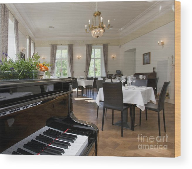 Chairs Wood Print Featuring The Photograph Piano In A Upscale Dining Room By Jaak Nilson