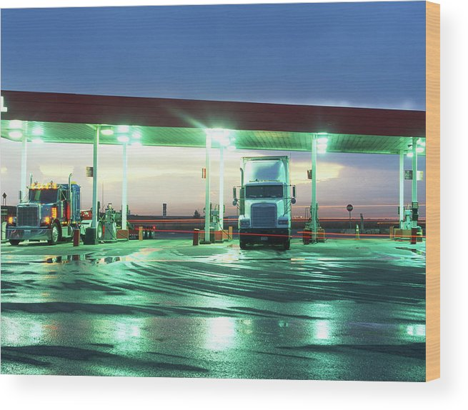 Clear Sky Wood Print featuring the photograph Two Semi Trucks Parked At Gas Station by Brad Rickerby