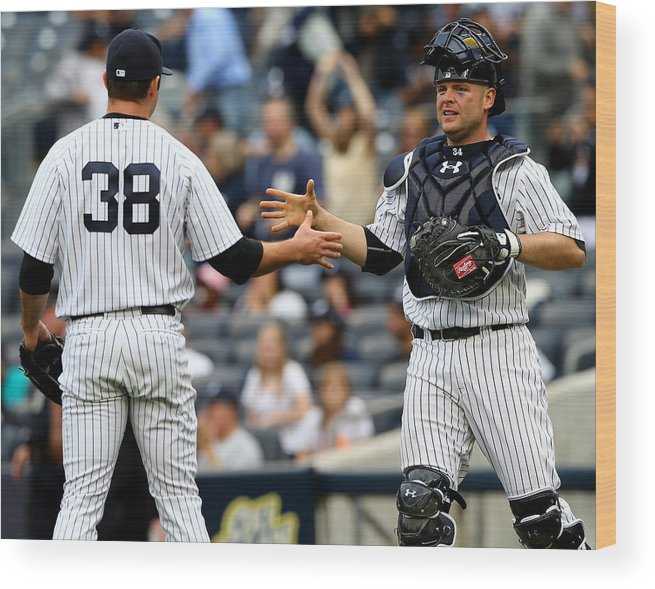 Brian Mccann Wood Print featuring the photograph Tampa Bay Rays V New York Yankees by Elsa