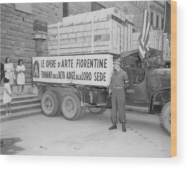 History Wood Print featuring the photograph U.s. Soldier Guards A Truck Holding by Everett