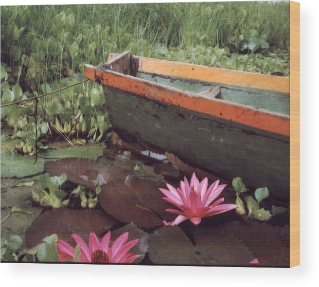 Boat Wood Print featuring the photograph Colombian Boat And Flowers by Lawrence Costales