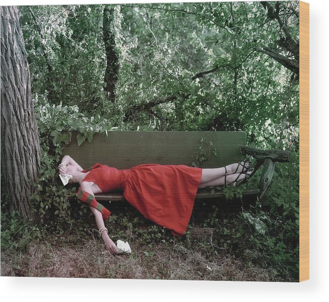 Accessories Wood Print featuring the photograph A Woman Lying On A Bench by John Rawlings