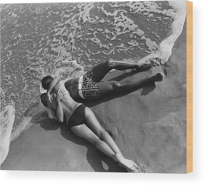 Model Wood Print featuring the photograph Models Embracing On A Beach by Mark Patiky