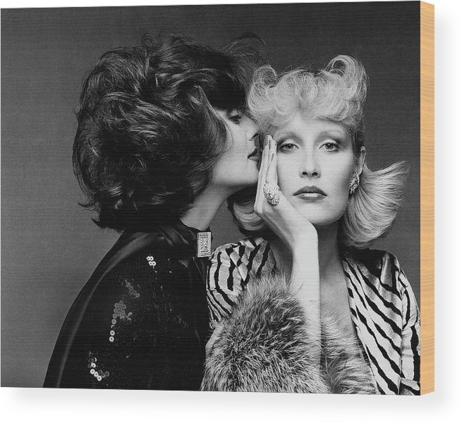 Accessories Wood Print featuring the photograph Two Models Wearing Wigs By Edith Imre by Francesco Scavullo
