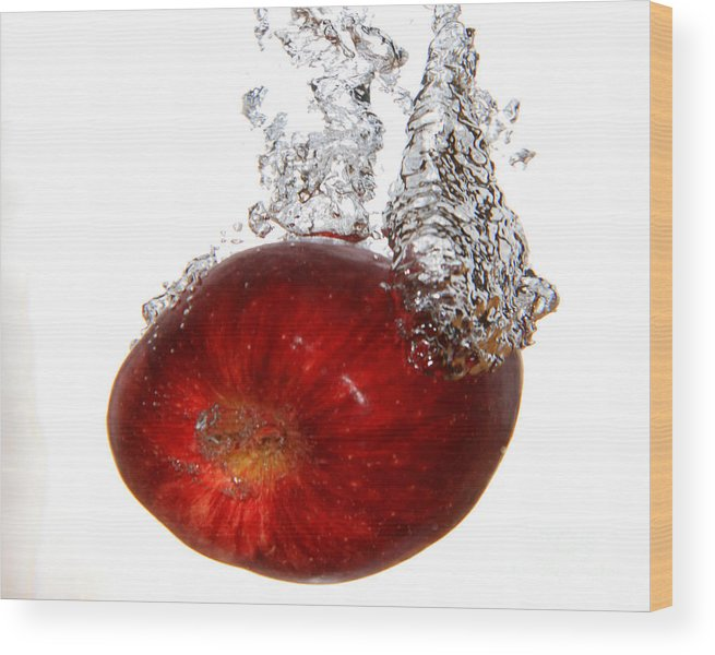 Water Wood Print featuring the photograph Red Apple Dropped by Lloyd Alexander