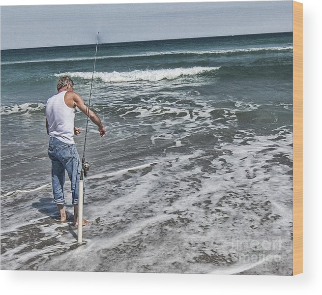 Beach Blue Coast Color Colour Dawn Fish Fisherman Fishing Fun Leisure Male Man Nature Ocean Outdoors Wood Print featuring the photograph Fishing On The Beach by Debbie Herb