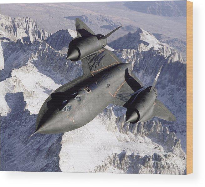 Horizontal Wood Print featuring the photograph Sr-71b Blackbird In Flight by Stocktrek Images