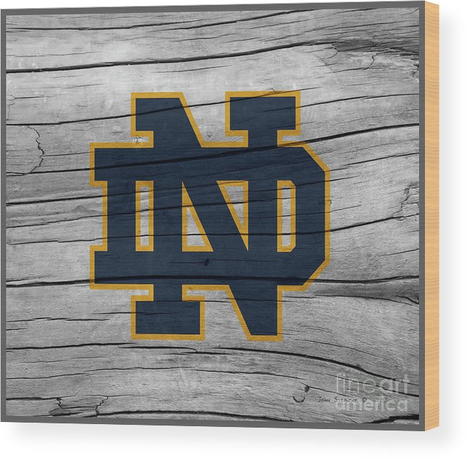 Football Wood Print featuring the photograph University Of Notre Dame Fighting Irish Logo On Rustic Wood by John Stephens