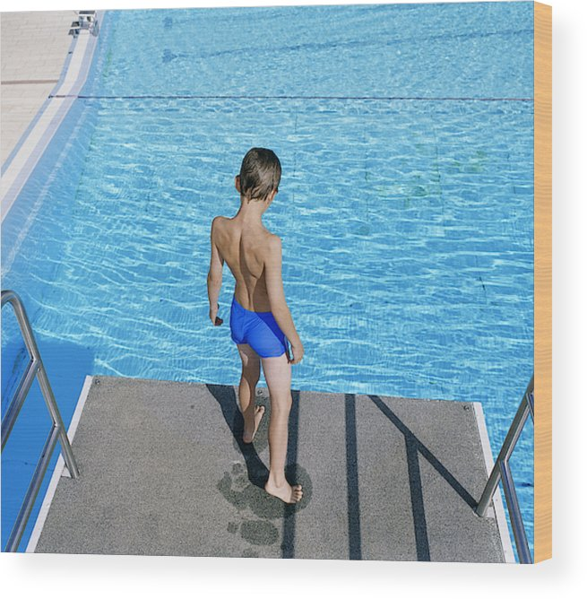 Boy (8-9) Standing On Diving Board Over Swimming Pool Wood Print
