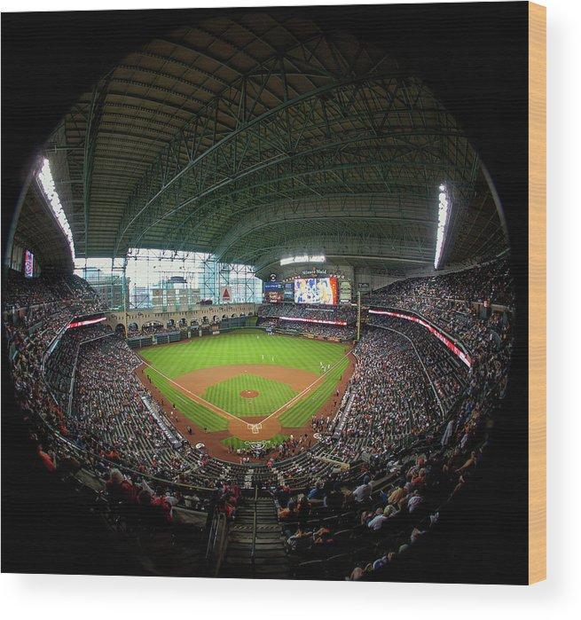 American League Baseball Wood Print featuring the photograph Texas Rangers V Houston Astros by Bob Levey