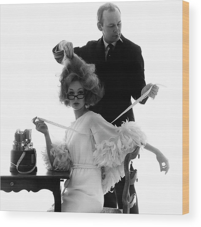 Beauty Wood Print featuring the photograph Hairstylist Kenneth Holding The Hair Of A Model by Bert Stern