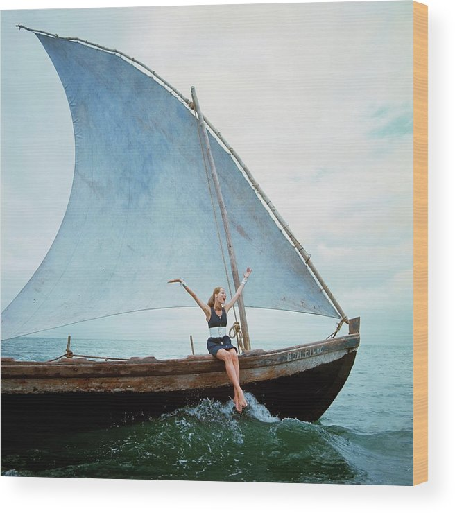 Boat Wood Print featuring the photograph Veruschka Von Lehndorff Sitting On Edge by Franco Rubartelli