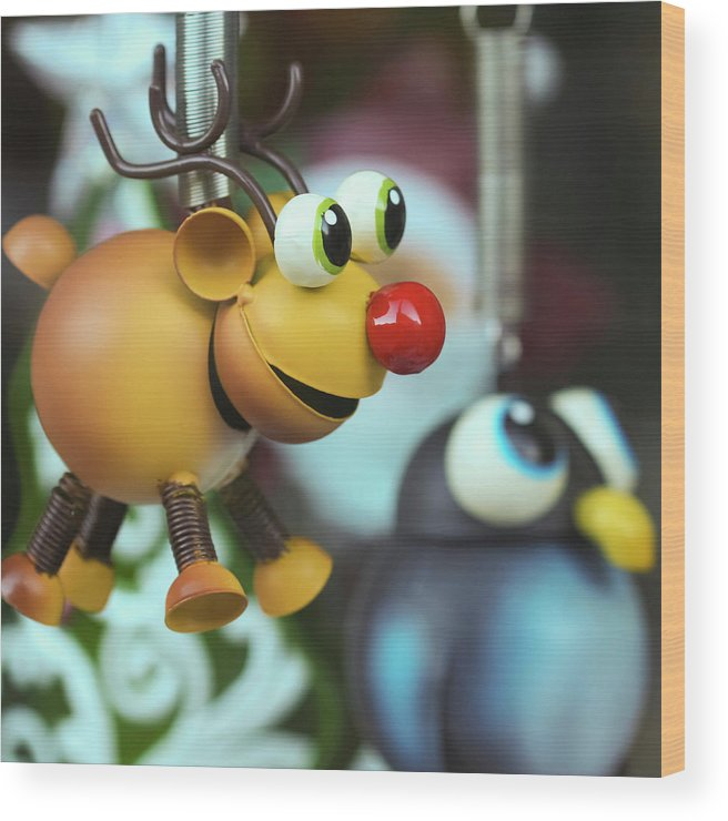 Season Wood Print featuring the photograph A Rudolph The Red Nosed Reindeer Ornament With A Penguin by Derrick Neill