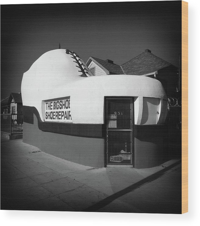 Black And White Wood Print featuring the photograph The Big Shoe by Roland Peachie