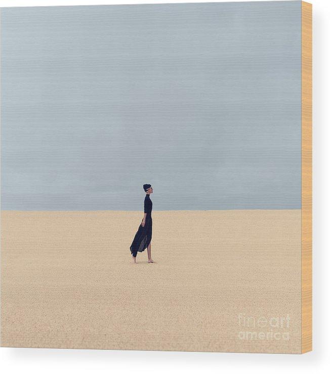 Dress Wood Print featuring the photograph Stylish Girl In Black Clothes Walking by Evgeniya Porechenskaya