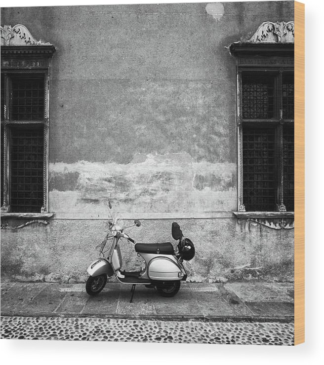 Two Objects Wood Print featuring the photograph Vespa Piaggio. Black And White by Claudio.arnese