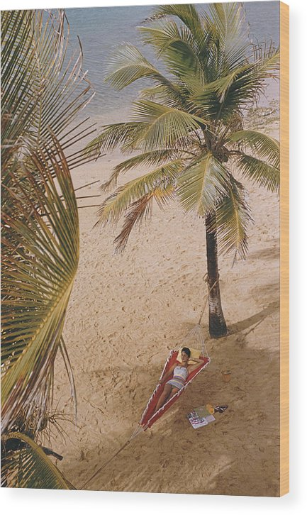 Tranquility Wood Print featuring the photograph Caribe Hilton Beach by Slim Aarons