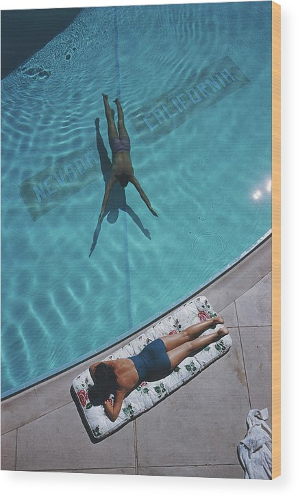 Young Men Wood Print featuring the photograph Swimmer And Sunbather by Slim Aarons