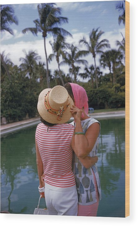 Lilly Pulitzer Wood Print featuring the photograph Poolside Secrets by Slim Aarons
