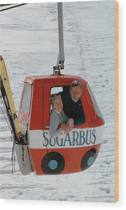 People Wood Print featuring the photograph Snow Lift by Slim Aarons