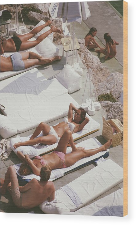 Recreational Pursuit Wood Print featuring the photograph Sunbathers At Eden Roc by Slim Aarons