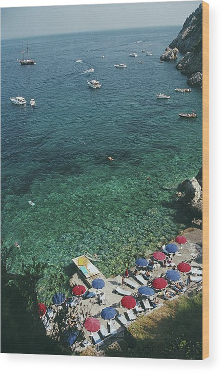 Sunbathing Wood Print featuring the photograph View From Il Pellicano by Slim Aarons