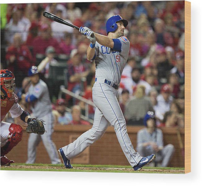 Following Wood Print featuring the photograph Chicago Cubs V St. Louis Cardinals by David Welker