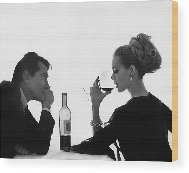 Entertainment Wood Print featuring the photograph Man Gazing at Woman Sipping Wine by Bert Stern