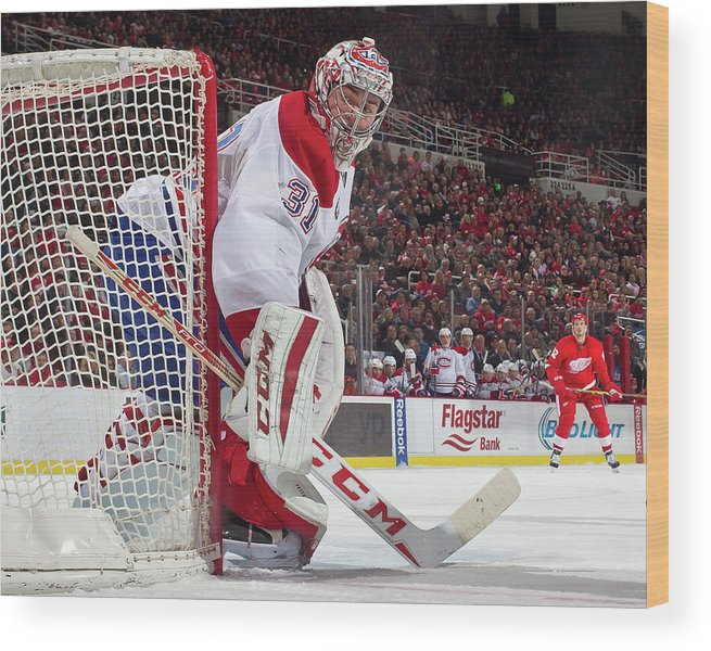 Following Wood Print featuring the photograph Montreal Canadiens V Detroit Red Wings by Dave Reginek