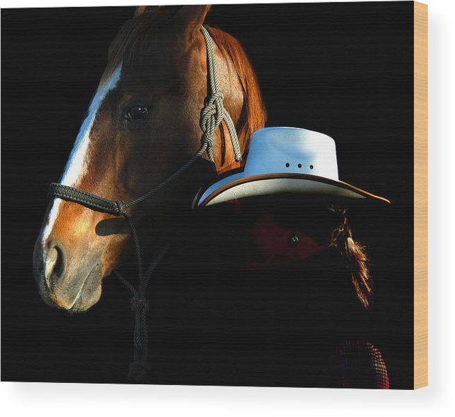 A Woman Wrangler And Her Horse Pose Together While On The White Horse Ranch In Southeastern Oregon. Wood Print featuring the photograph Oregon by Lourie Zipf