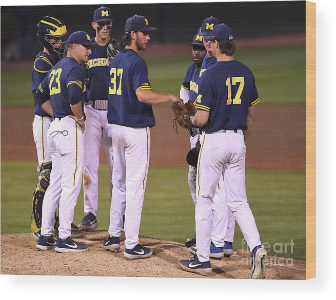 Sports Ball Wood Print featuring the photograph Michigan V Ucla - Game One by Jayne Kamin-oncea