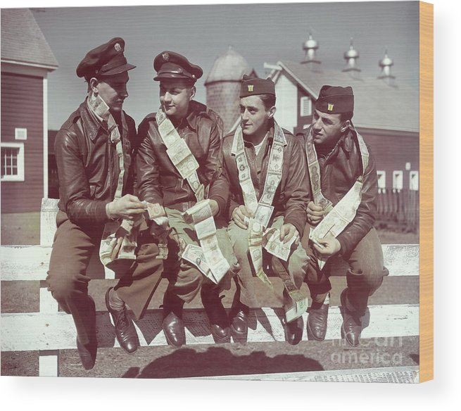 Young Men Wood Print featuring the photograph Air Force Gunners Comparing Short by Bettmann