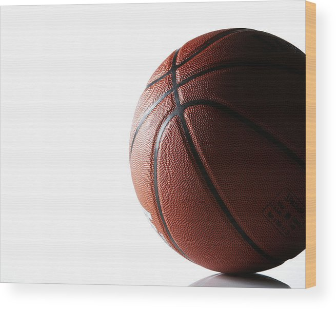 Recreational Pursuit Wood Print featuring the photograph Basketball On White Background by Thomas Northcut
